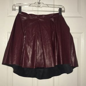 Burgundy colored skirt with designs